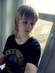 me, pensive on windowsill