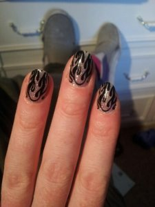 meantime, here are my nails!  Silver flame wraps that I bought in Reykjavic earlier this year.